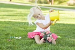 Little Blonde Girl Gardening with Watering Can and Flower Pot Stock Images