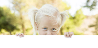 Little Blonde Girl Holding White Board with Room For Text Royalty Free Stock Image