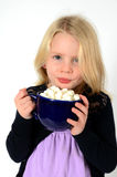 Little blonde girl with hot cocoa. Little girl holding blue mug of hot cocoa and marshmallows Royalty Free Stock Image