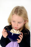 Little blonde girl with hot cocoa. Little girl holding blue mug of hot cocoa and marshmallows Stock Photography