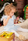 Little blonde girl with lipstick and mirror Royalty Free Stock Photos