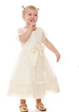 Little blonde girl in a long air Royalty Free Stock Photography