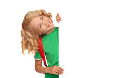 Little blonde girl over blank billboard Royalty Free Stock Images