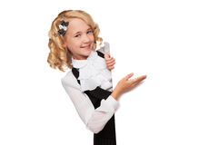 Little blonde girl over blank billboard Royalty Free Stock Image