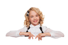 Little blonde girl over blank billboard Stock Photography
