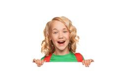 Little blonde girl over blank billboard Royalty Free Stock Image