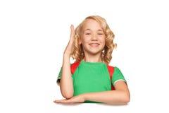 Little blonde girl over blank billboard Stock Photo