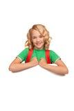Little blonde girl over blank billboard Royalty Free Stock Photos