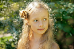 Little blonde girl in the park/ Summerday Stock Photos