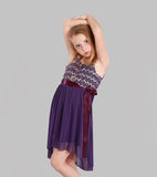 Little blonde girl in party dress Stock Images