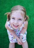Little blonde girl perfect smile. Stock Photo