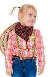 Little blonde girl with pigtails dressed as a cowboy  Stock Photos