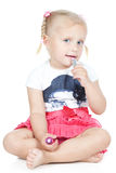Little blonde girl with pink lipstick Stock Photography