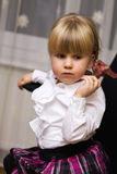 Little blonde girl with plaits stock photography