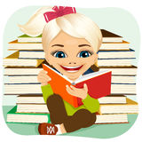 Little blonde girl reading an interesting book Royalty Free Stock Photo