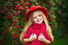 Young beautiful little stylish girl in a sunny autumn park royalty free stock images