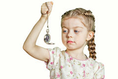 Little blonde girl with silver watch Stock Photography