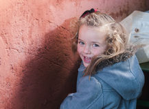 Little blonde girl smiling Stock Photo