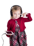Little blonde girl smiling listening to music on Stock Image