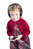 Little blonde girl smiling listening to music Stock Photos