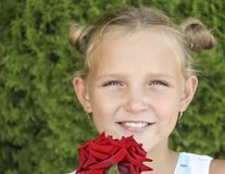 Little blond girl smiling portrait, on the nature Royalty Free Stock Photo