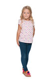 Little blonde girl stands against the white Royalty Free Stock Photo