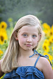 Little blonde girl in sunflower field Royalty Free Stock Image