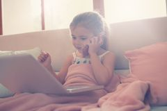 Little girl using her laptop. Royalty Free Stock Photo