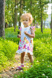 Little blonde girl walking in park Royalty Free Stock Images