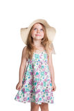 Little blonde girl wearing big white hat and dress looking up Stock Photos