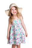Little blonde girl wearing big white hat and dress making faces Stock Photo