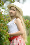 Little blonde girl wearing a hat Stock Image