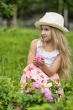 Little blonde girl wearing a hat Stock Images