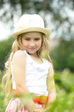 Little blonde girl wearing a hat Stock Photo