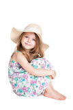 Little Blonde Girl Wearing White Hat And Dress Sitting On The Fl
