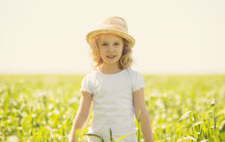 Little blonde girl in a wheat field Royalty Free Stock Photos