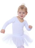 The little blonde girl in a white sports dress up Royalty Free Stock Image