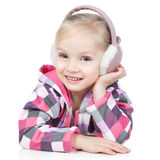 Little blonde girl in winter headphones on white Stock Photos