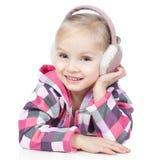 Little blonde girl in winter headphones on white Stock Photos
