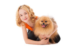 Little blonde smiling girl holding her dog Royalty Free Stock Photo