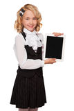 Little blonde student wearing uniform holding tablet Stock Photo