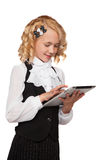 Little blonde student wearing uniform holding tablet Royalty Free Stock Photo