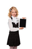 Little blonde student wearing uniform holding tablet Stock Photos
