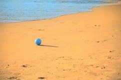 Blue ball. Little blue ball on the beach royalty free stock photo