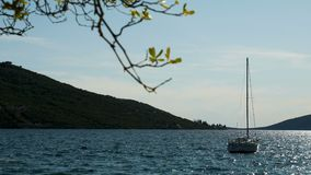 Little blue boat in the sea near the mountains. In Montenegro stock video footage