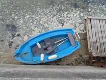 Small blue boat seen from above royalty free stock images