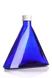 Little blue bottle isolated Royalty Free Stock Photography