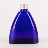 Little blue bottle isolated Royalty Free Stock Photos