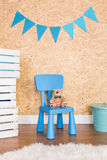 Little blue chair for little man Stock Images
