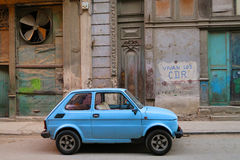 A little blue Cuban retro retro. Cuba, Havana - 08 April, 2016: a little retro car is parked in one of the streets of Havana, Cuba, being a perfect element of Stock Photos